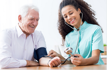 smiling female nurse practitioner taking blood pressure for smiling male geriatric patient